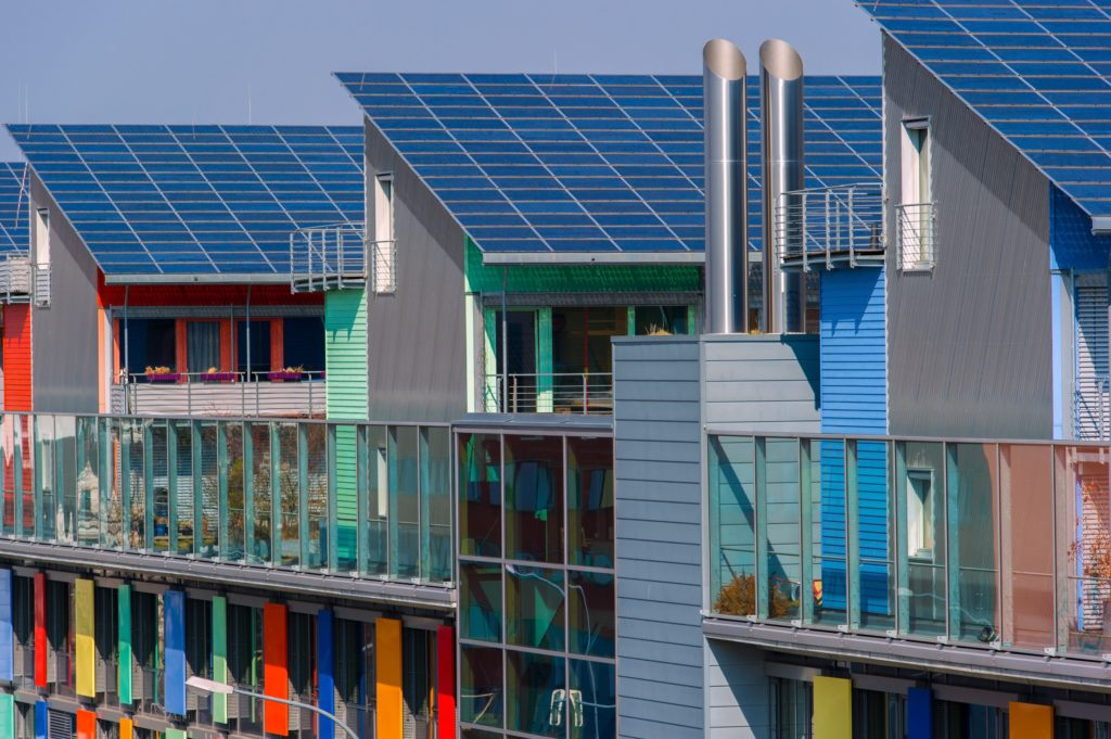 FREIBURG IM BREISGAU, GERMANY - MARCH 23: Solar panels stand on the roof of the Sun Ship part of the Freiburg Solar Settlement on March 23, 2012 in Freiburg im Breisgau, Germany. The Solar Settlement is an ensemble of 59 homes and a commercial building created from sustainable materials generating 445 kW, per year from its solar panels. The photovoltaic roofs produce more energy than consumed by the settlement and whose supplementary income largely compensates its low additional costs. (Photo by Harold Cunningham/Getty Images)